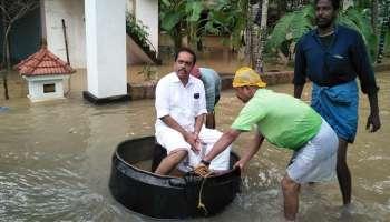 'പ്രളയ പ്രഹസനം': പാദം മുങ്ങാത്തിടത്ത് ചെമ്പിലിരുന്ന് കോണ്ഗ്രസ് നേതാവ്!!